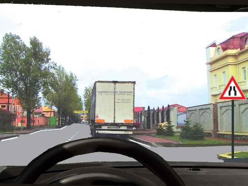 Camionul este staţionat. Cine încalcă legea dacă încercaţi să-l depăşiţi?