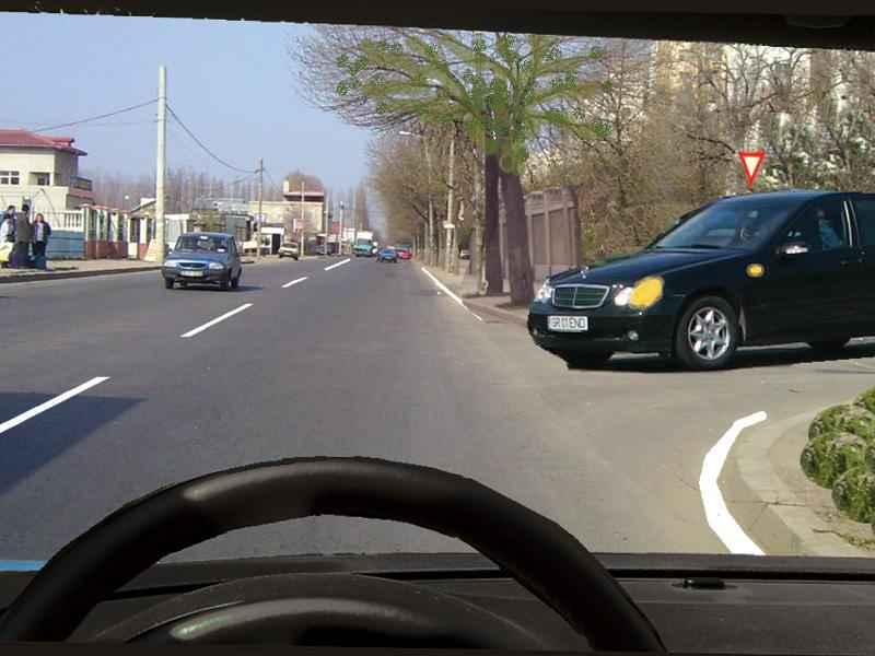 Trebuie să acordaţi prioritate autoturismului gri dacă acesta virează la stânga?